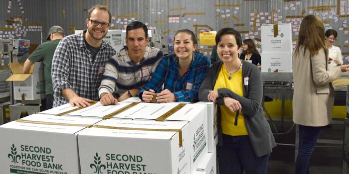 Team Heller volunteering at Second Harvest